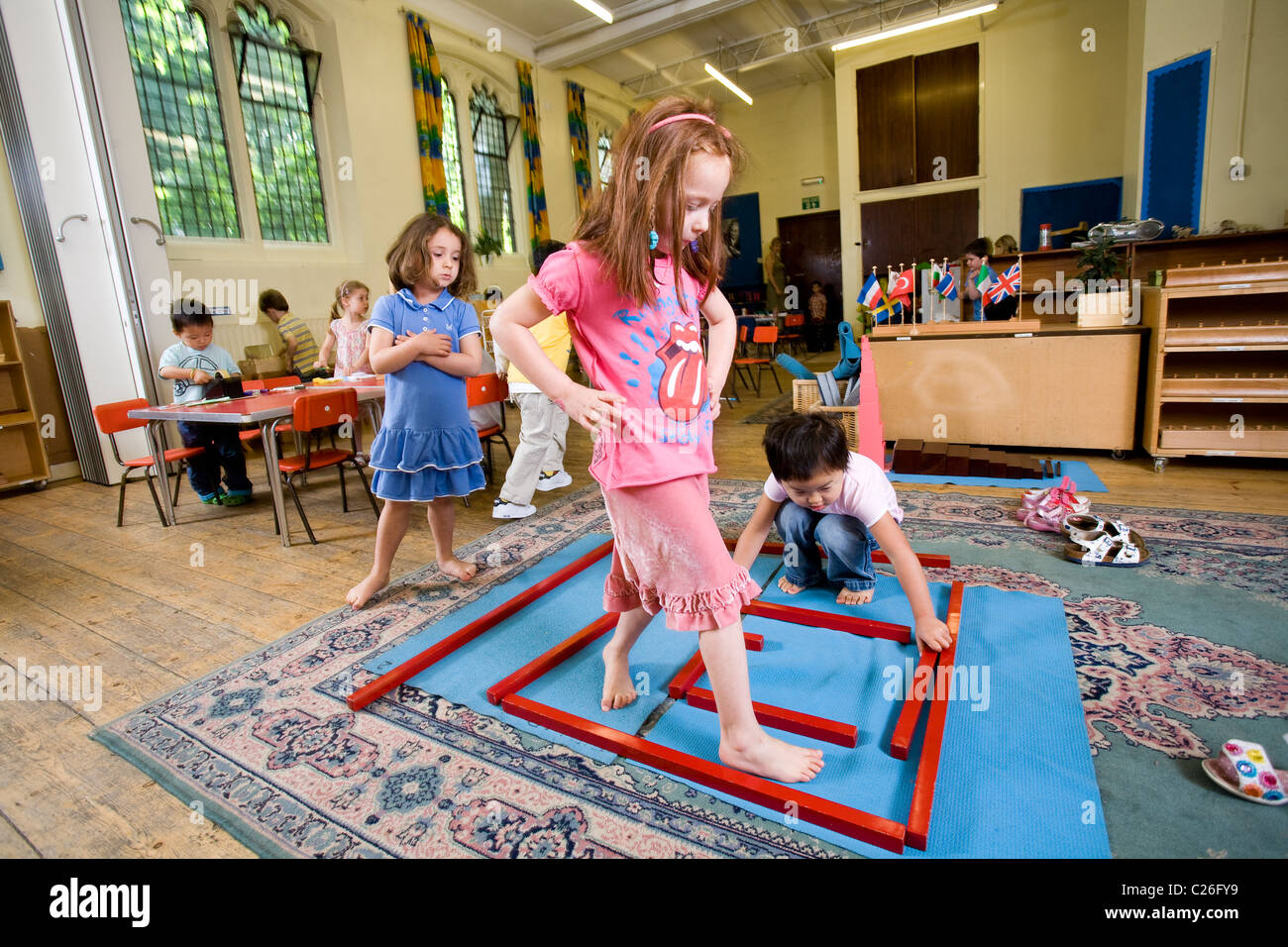 Children playing with alternative activities at Paint Pots Montessori school, Hyde Park Crescent, London W2.Photo:Jeff - Stock Image