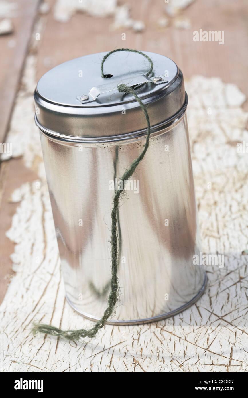 Gardeners Jute string in metal container - Stock Image