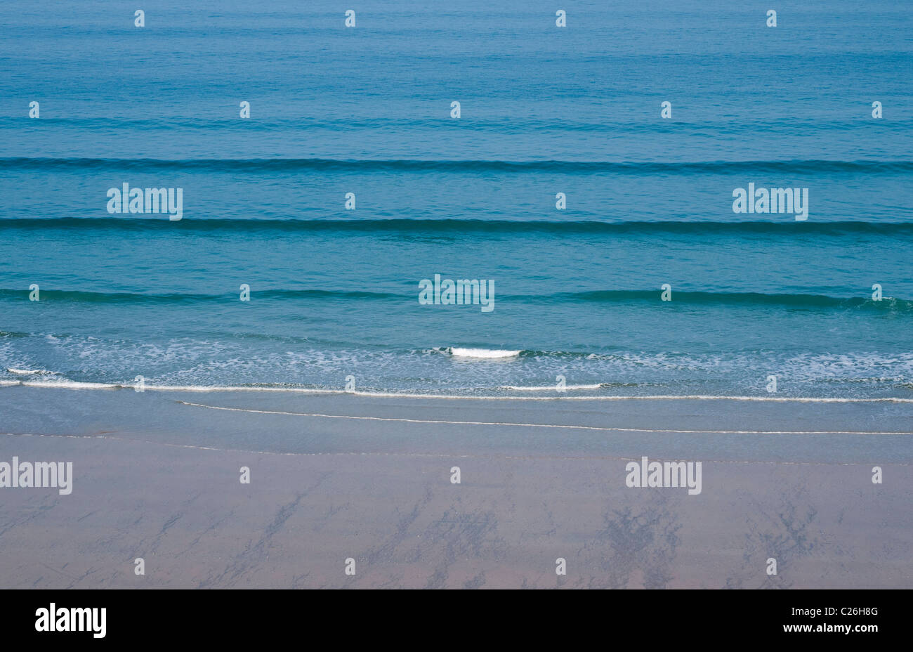 Gentle Waves on Beach at Newquay, Cornwall - Stock Image