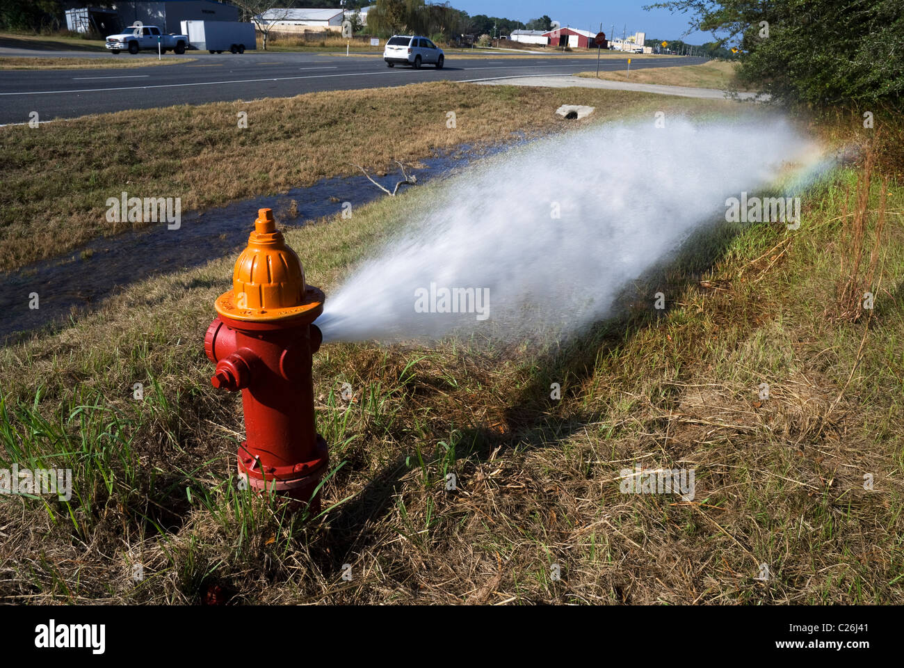 fire hydrant gushes water while undergoing maintenance and testing - Stock Image