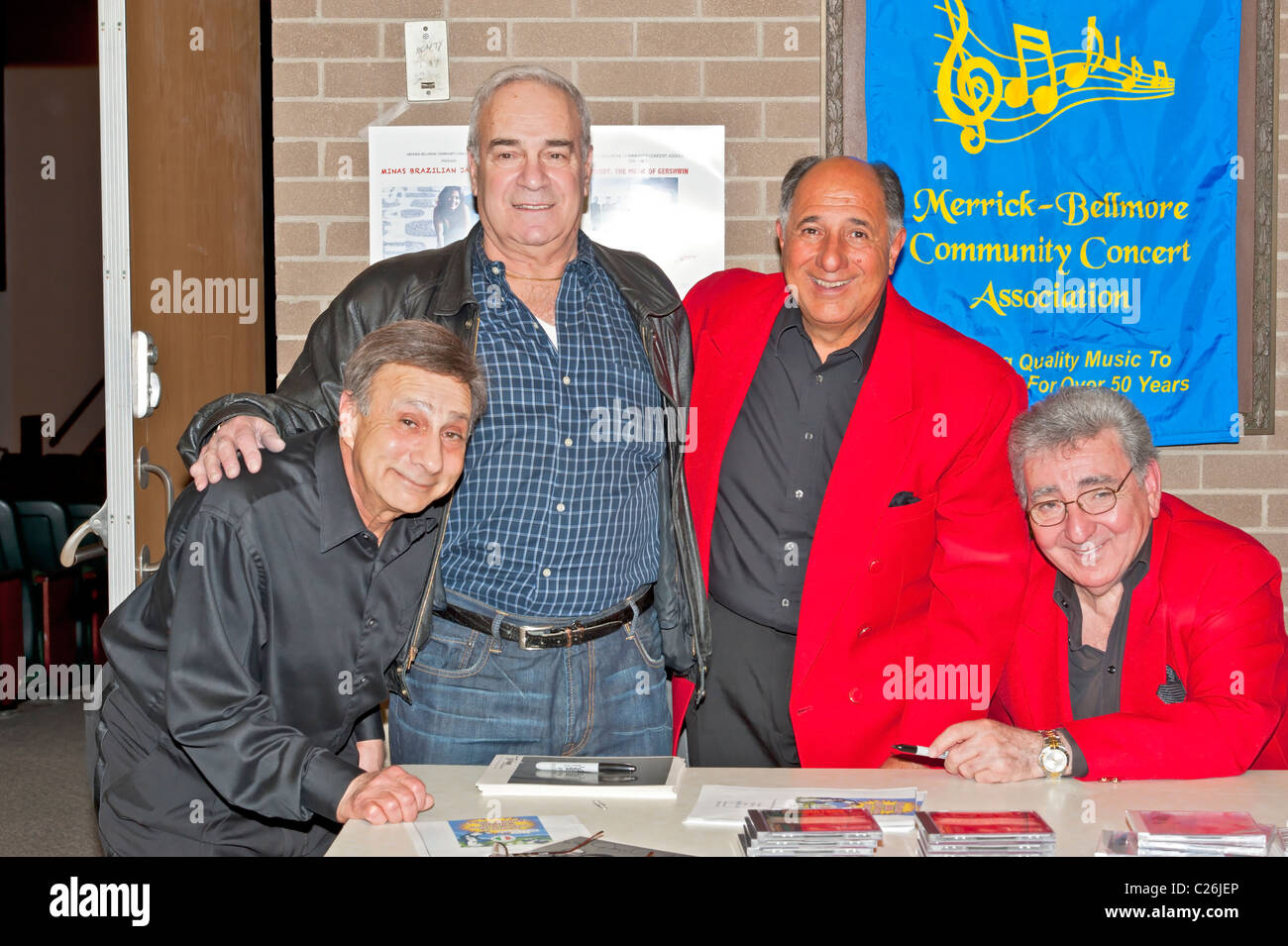 APRIL 2. 2011 - BELLMORE, NEW YORK: Danny and the Juniors Doo-Wop music group signing music CDs for fans after MBCCA - Stock Image