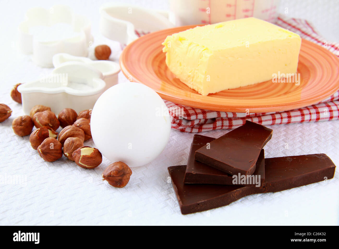 Basic baking ingredients, flour, eggs and  butter - Stock Image