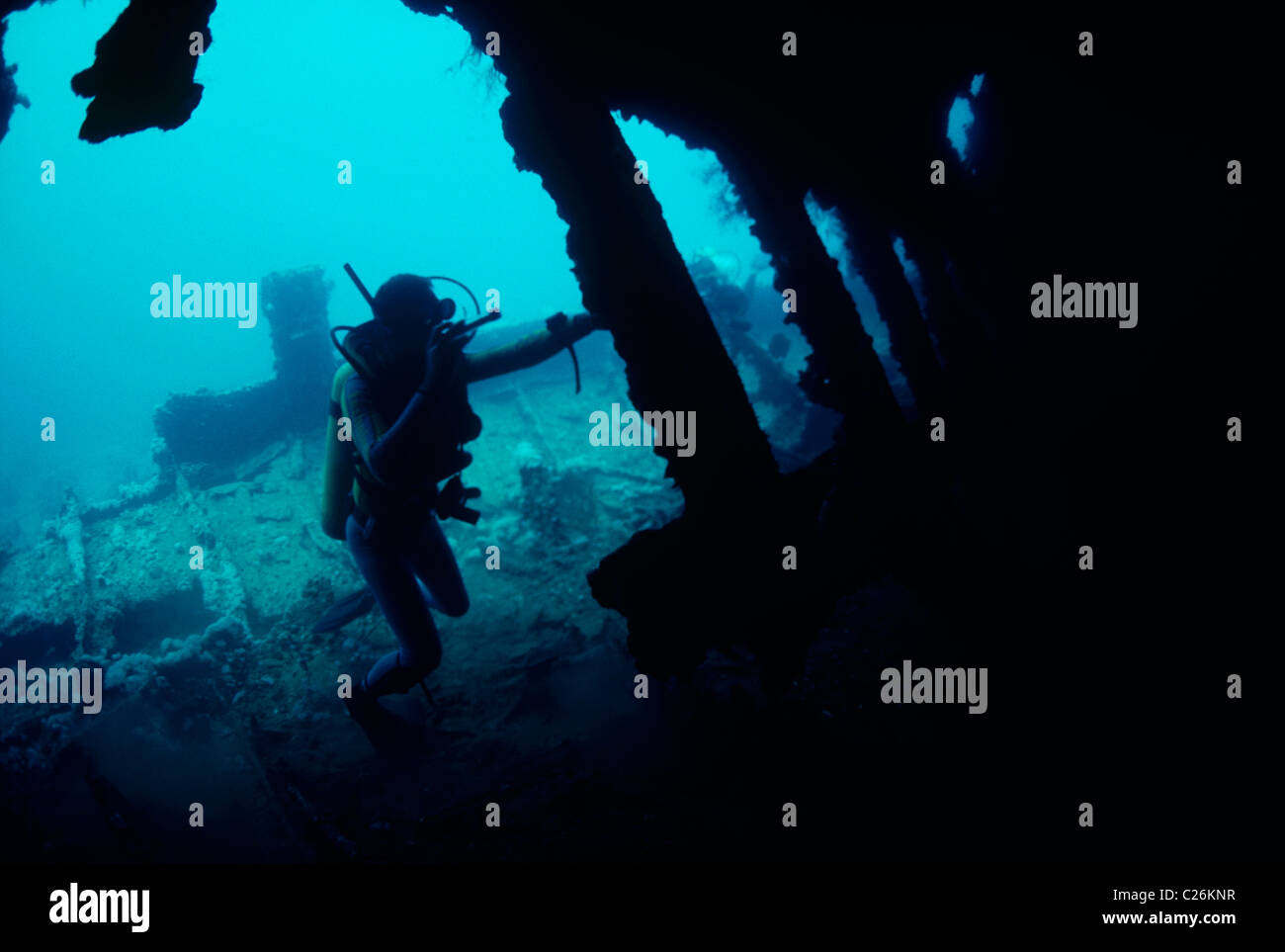 Diver exploring the 120 year old shipwreck 'Dunraven' . Red Sea - Egypt - Stock Image
