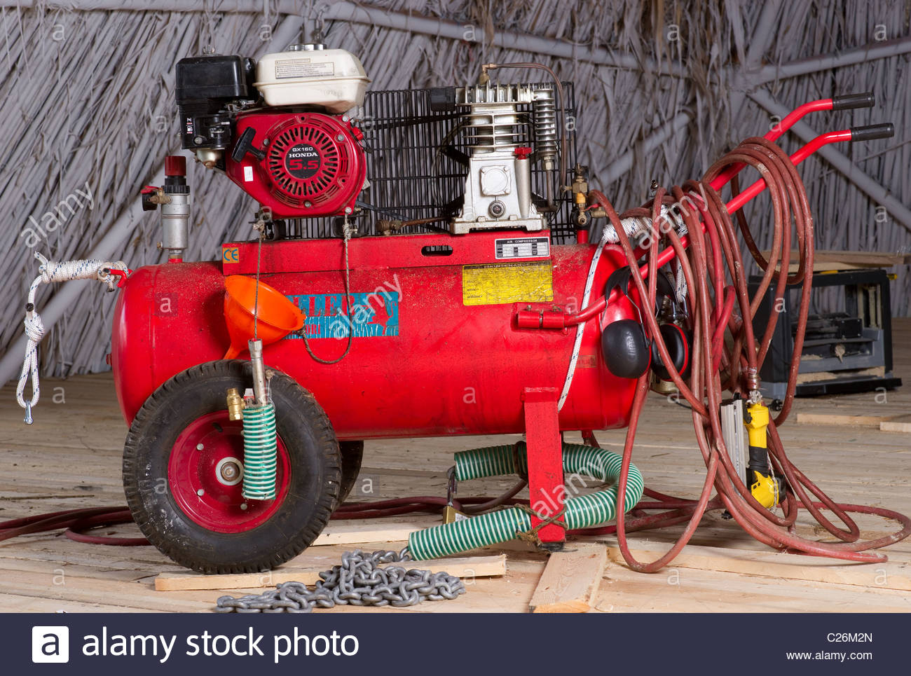 Air compressor petrol gasoline engine powered independent red compressors - Stock Image