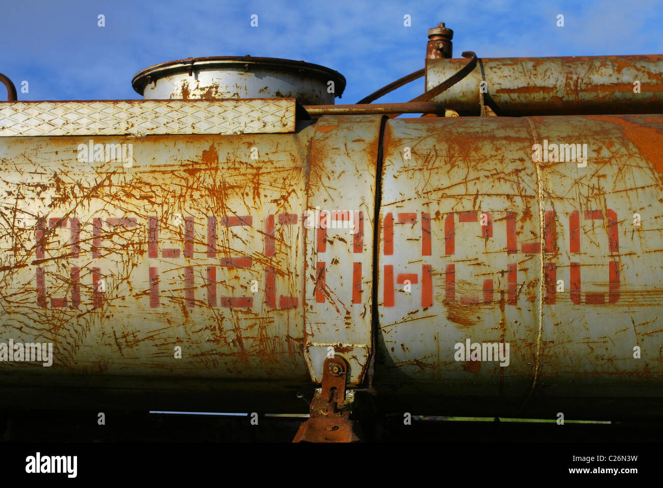 Rusty tank with the words 'flammable' in Russian. Yamal peninsula, RUSSIA - Stock Image