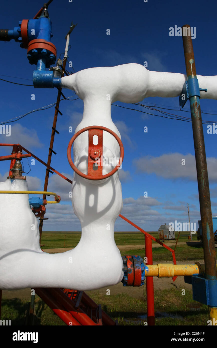 Icy pipe - part of gas-oil separation plant  Yamal, RUSSIA Stock