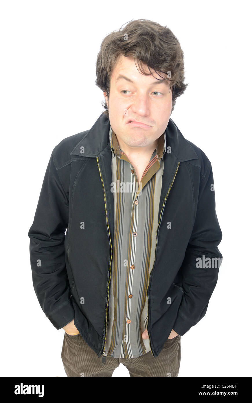 Man making an odd disgruntled face expression. - Stock Image
