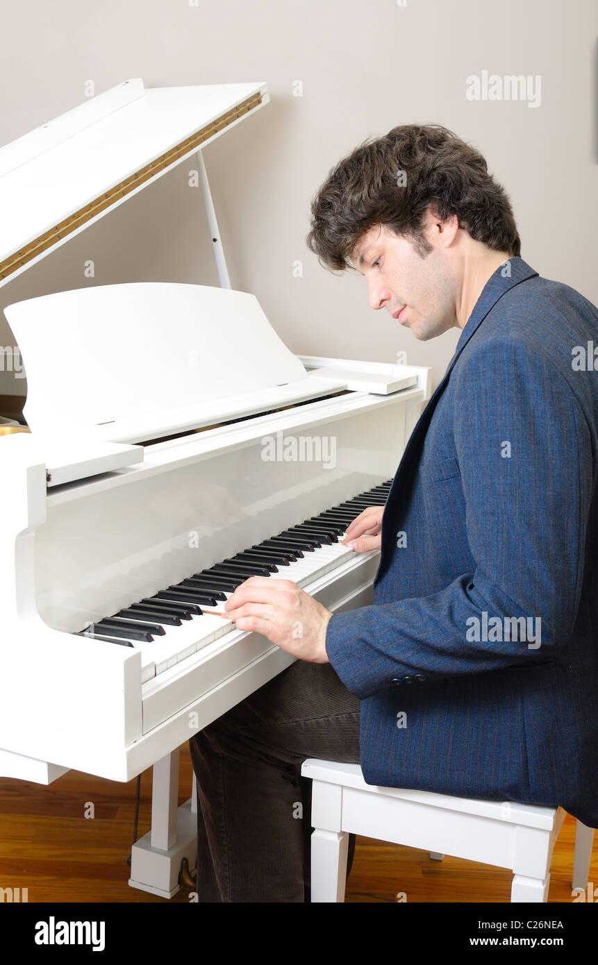 Piano detail with players hands - Stock Image