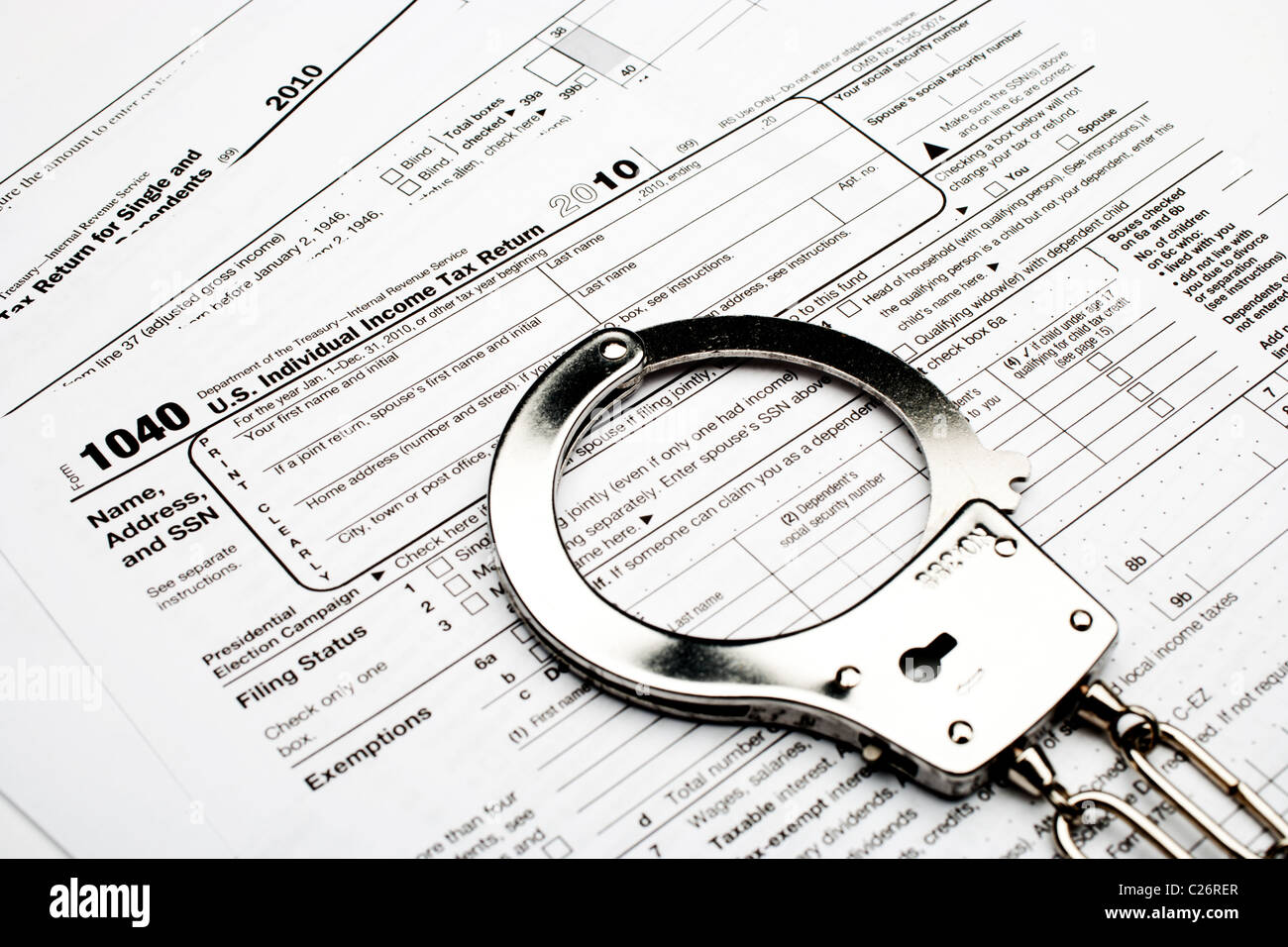 Handcuffs On An American 1040 Income Tax Form Indicating Tax Fraud