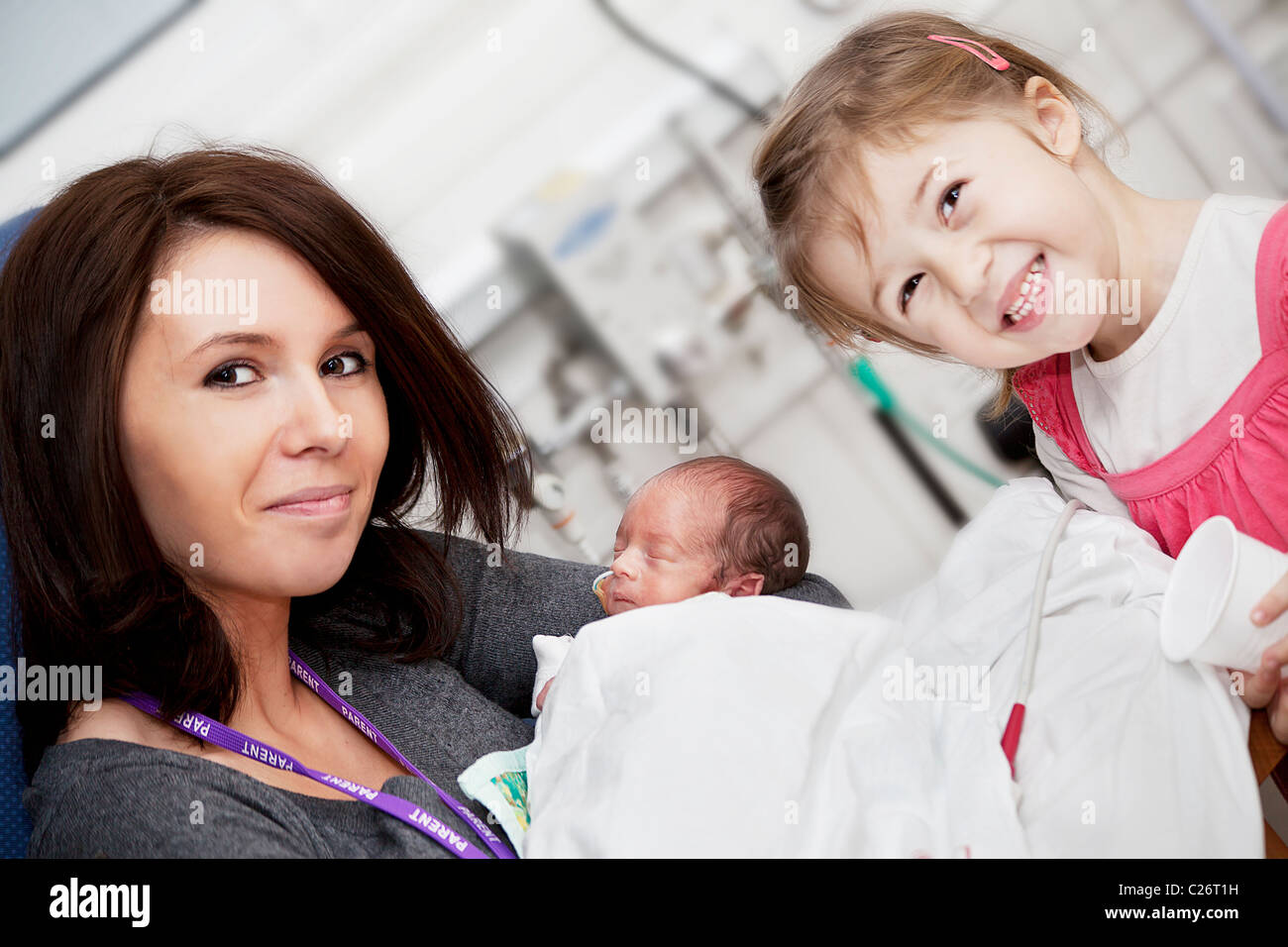 mum with her daughter and premature baby boy - Stock Image