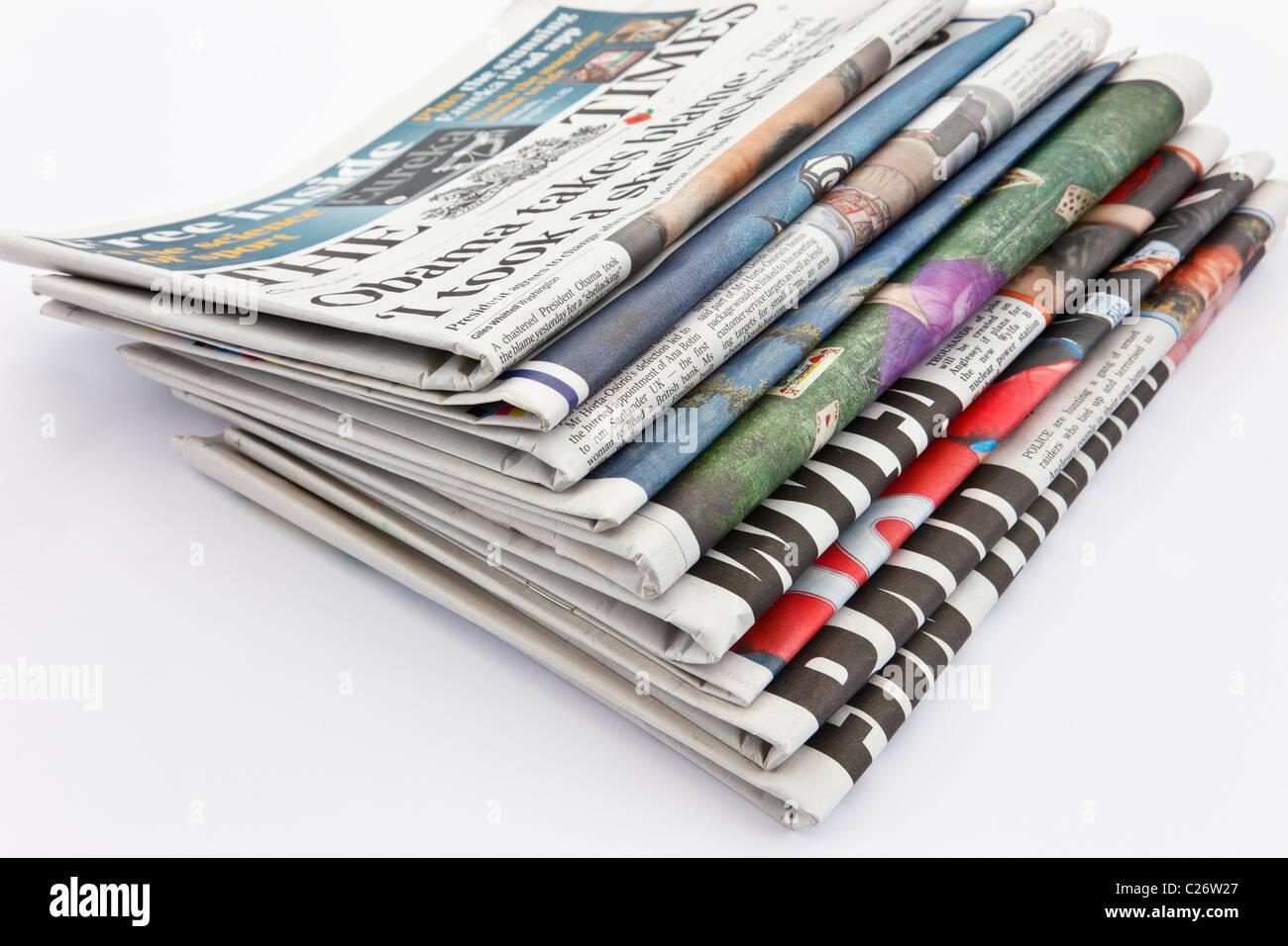 UK, Europe. Pile of newspapers Stock Photo