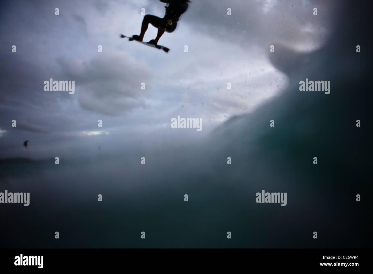 Kiteboarding Waimanalo @ Sunrise, female, Nina, airborne, airtime, jumping - Stock Image