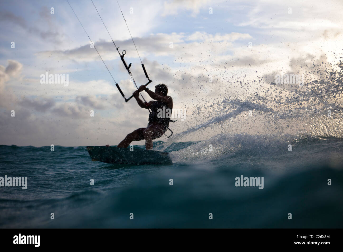 Kiteboarding Waimanalo @ Sunrise, male, David Giardini, carving some water - Stock Image