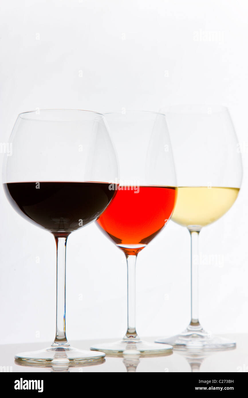 Glasses of White, Red and Rose Wines Stock Photo