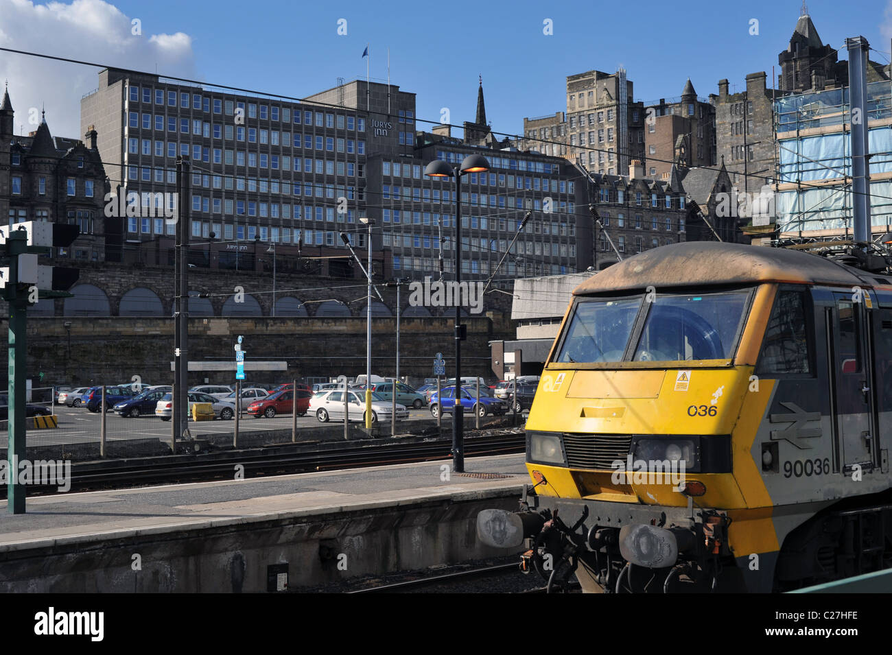 Jury's Inn Hotel Edinburgh from Waverley Train Station showing Scotrail train - Stock Image