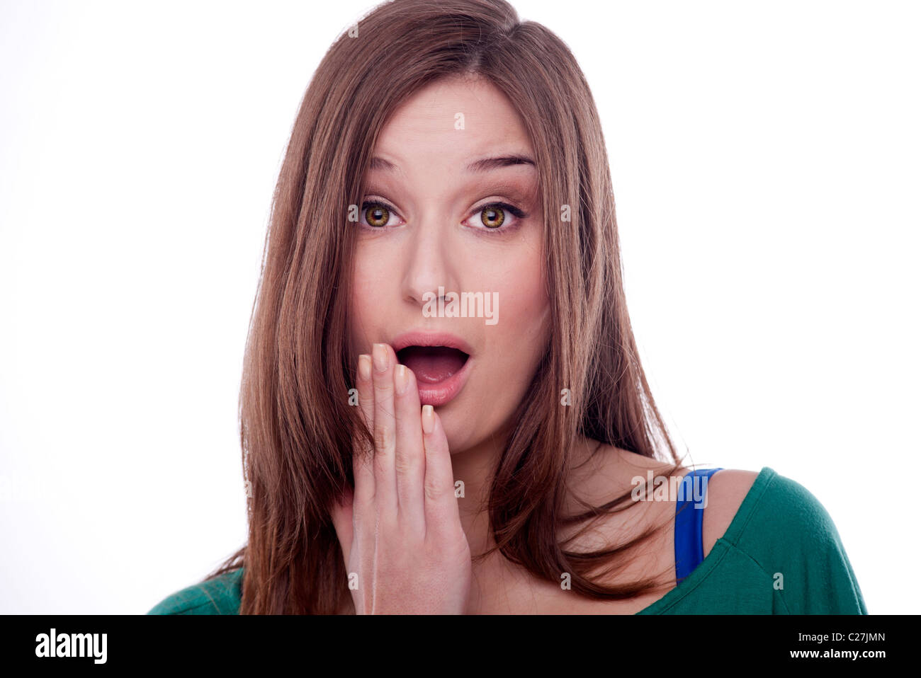Brunette woman looking shocked by what she has seen or heard - Stock Image