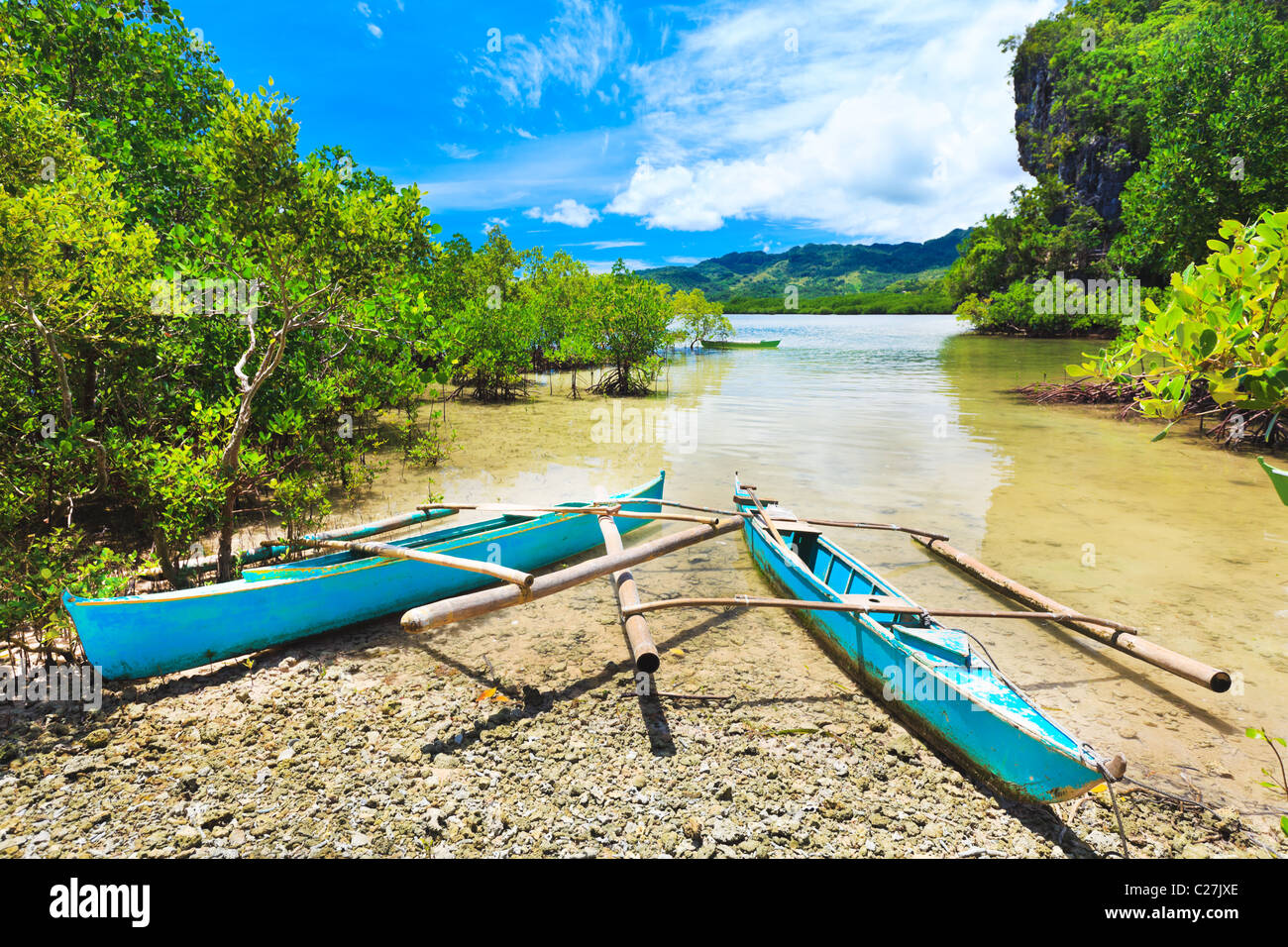 Traditional Philippine boat in the tropical lagoon - Stock Image