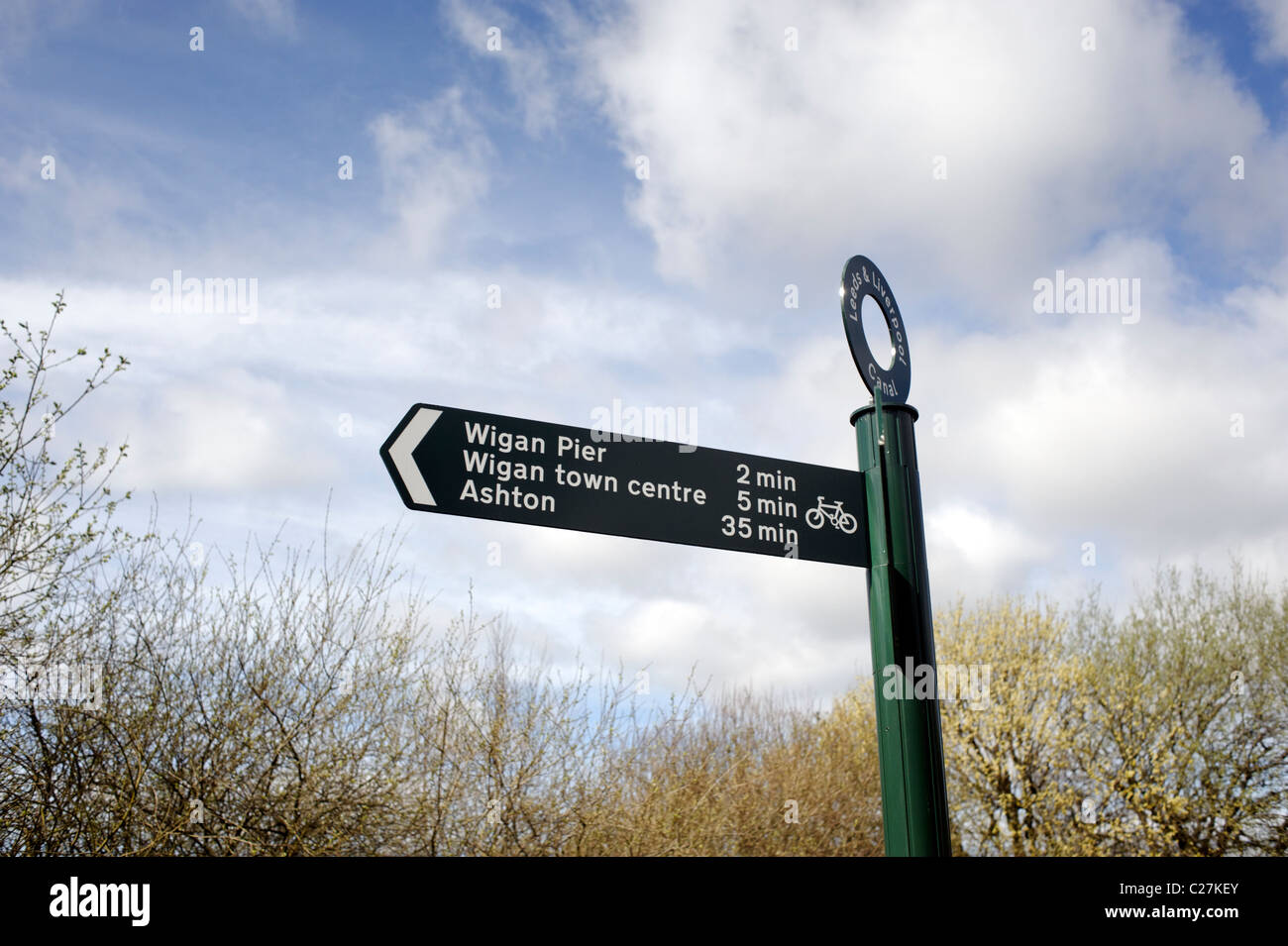 The cycle path to Wigan Pier - signpost in Wigan, Lancashire, England - Stock Image