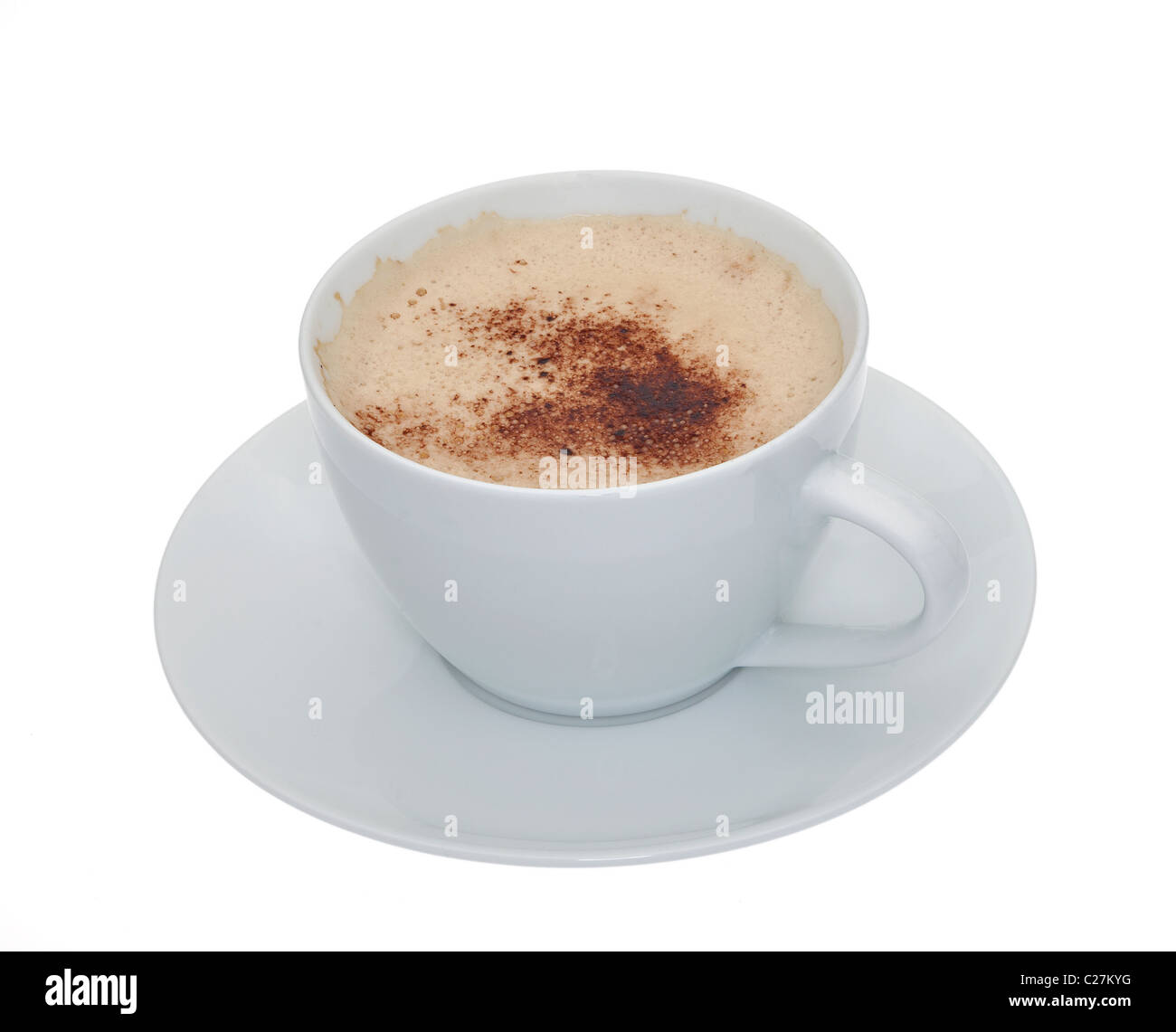 A cup of frothy coffee in a white cup and saucer isolated against a white background - Stock Image