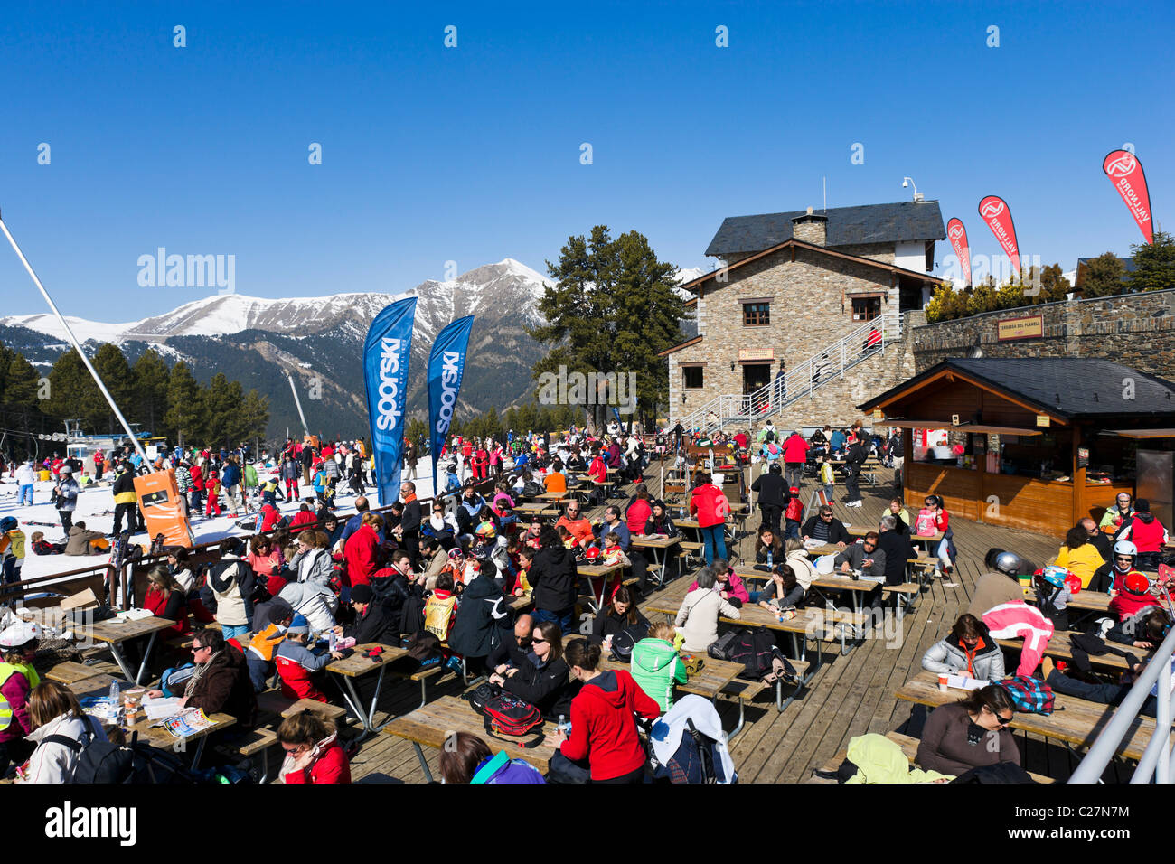 Terrace of a restaurant a the bottom of the slopes in Pal, Vallnord Ski Area, Andorra - Stock Image