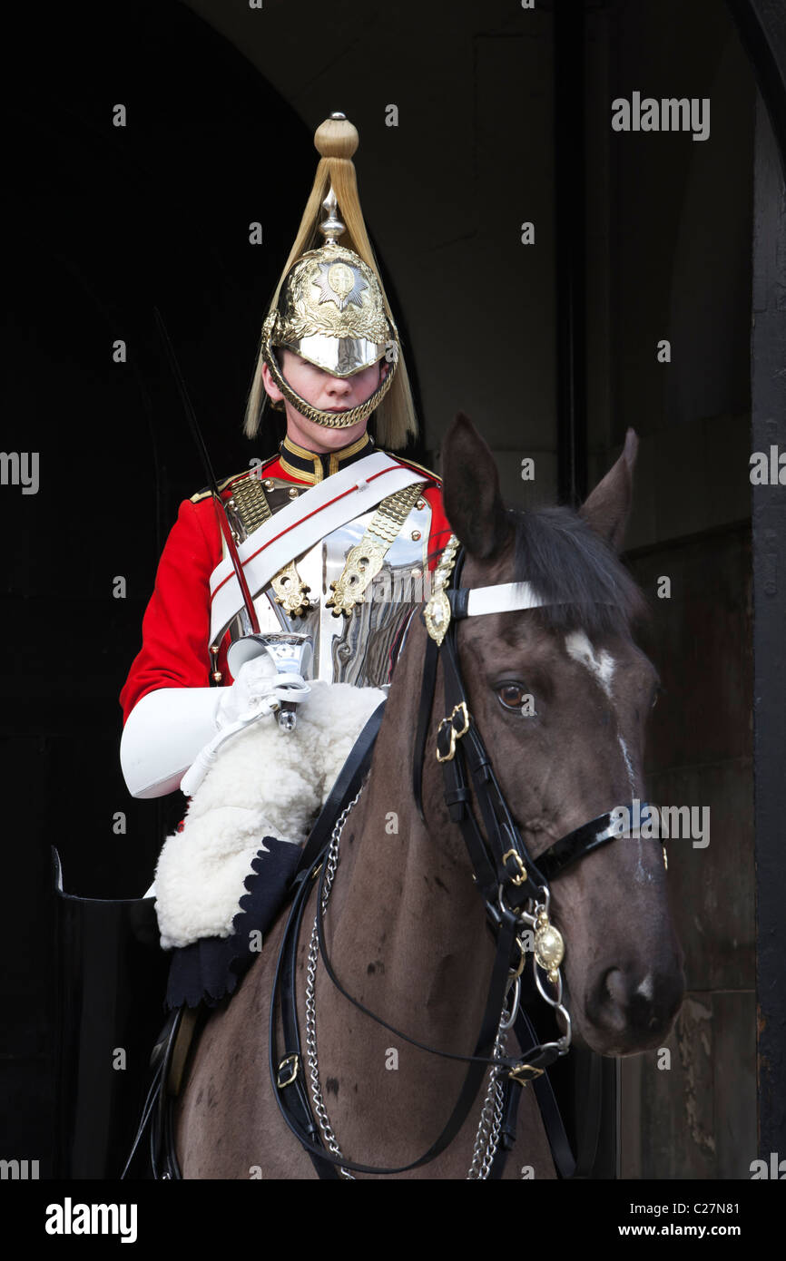 Mounted Life Guard of the Household Cavalry along Whitehall at Horse Guards Parade - Stock Image