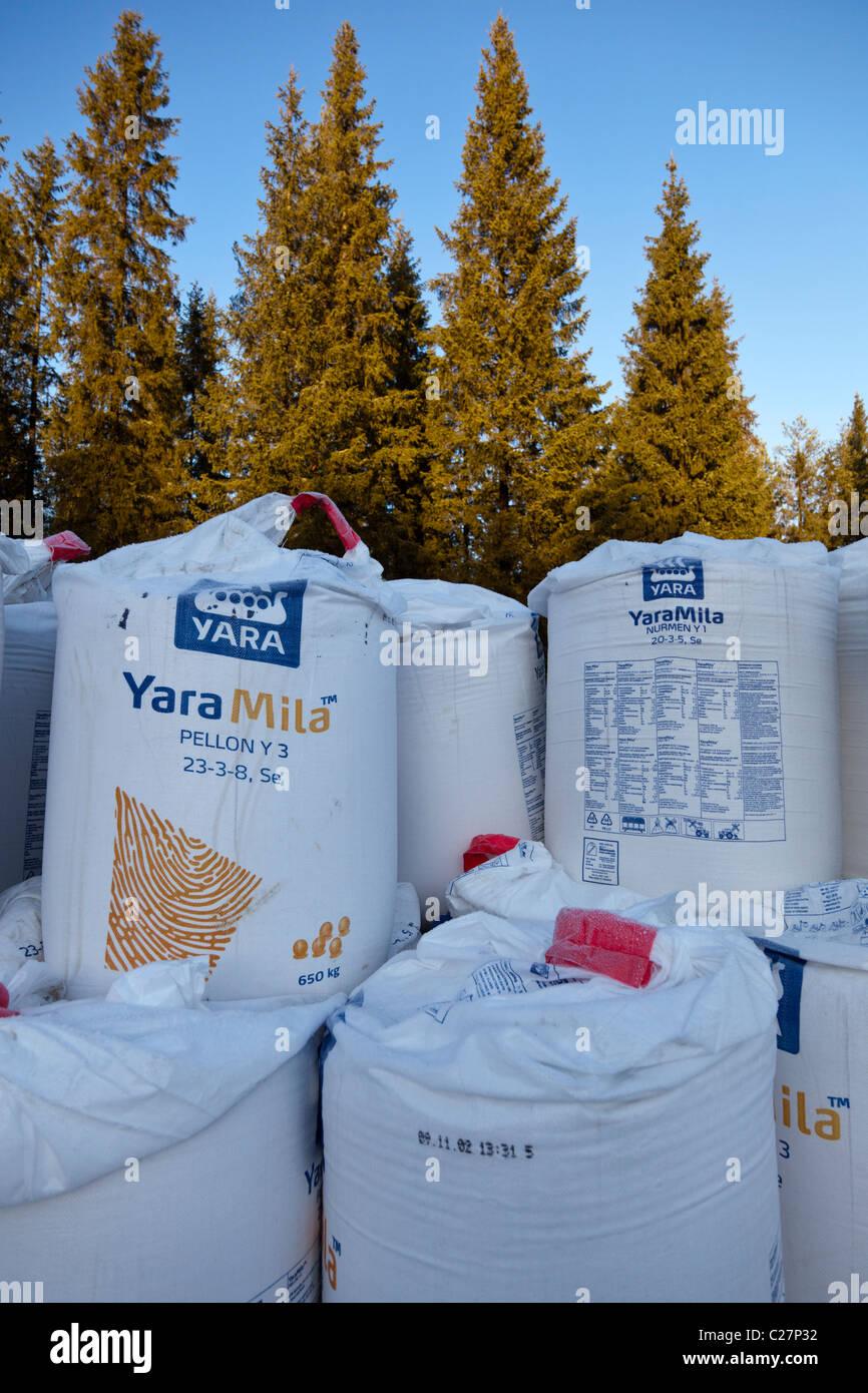 Pile of 650 kilogram NPK fertilizer ( Yara Mila ) sacks for agricultural use , fertilizing grass fields - Stock Image