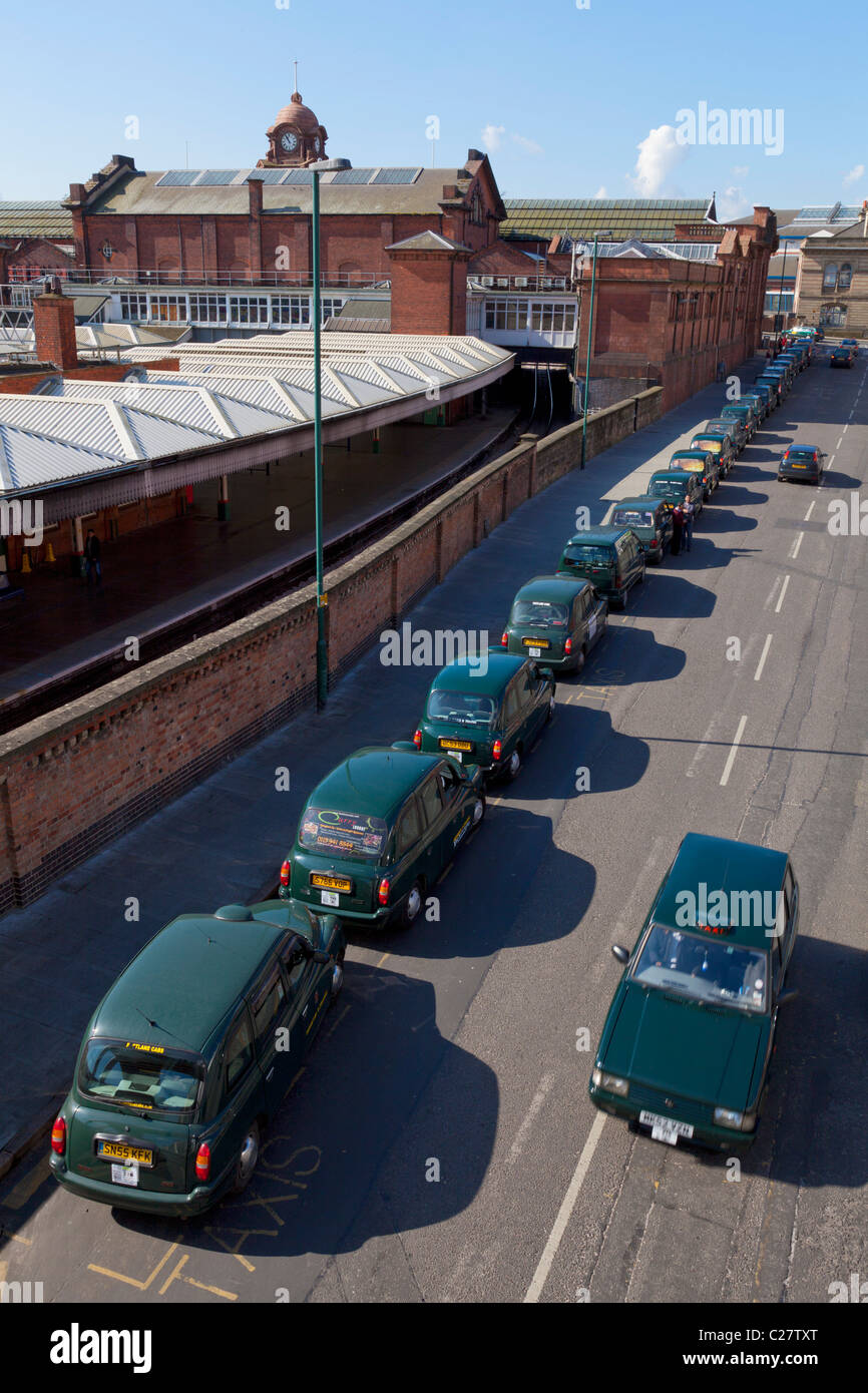 taxis waiting in a line outside the railway station Nottingham city centre England UK GB EU Europe Stock Photo