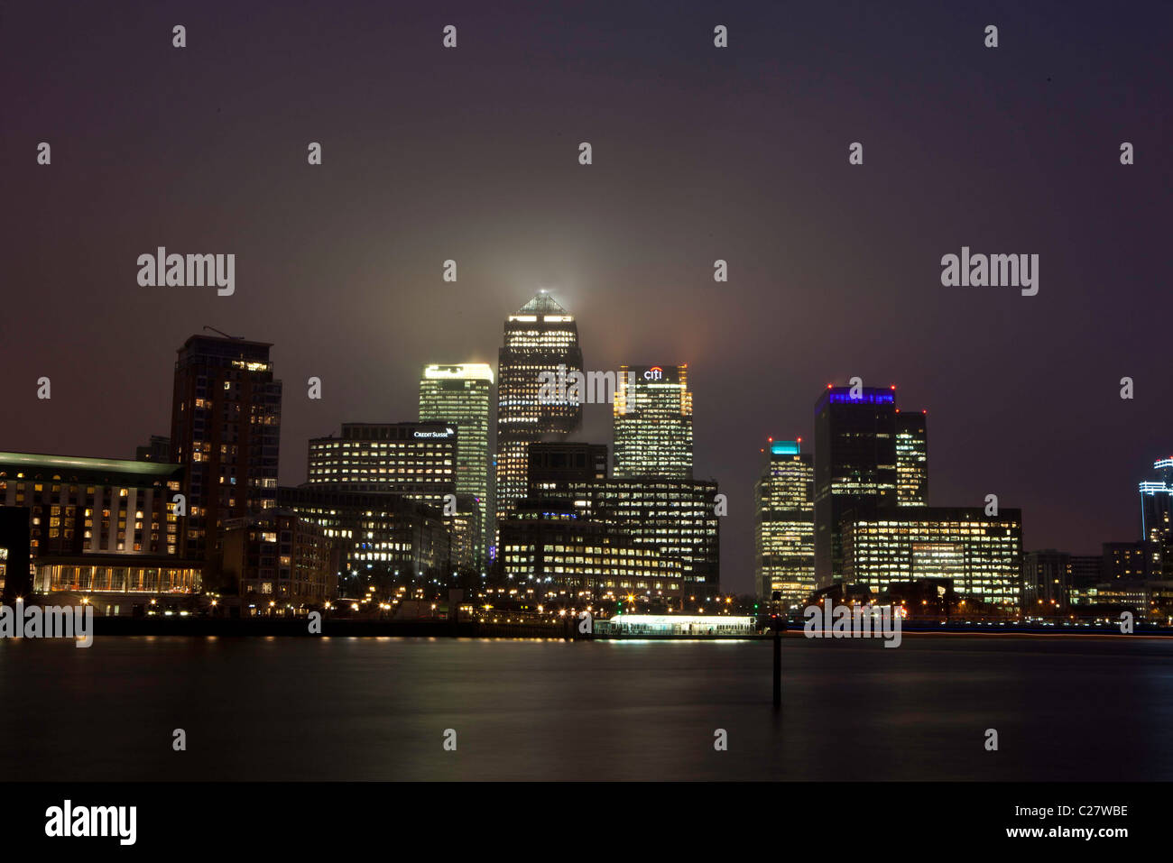 Docklands. Canary Wharf lit up at night, London. This is one of London's financial and business districts. - Stock Image