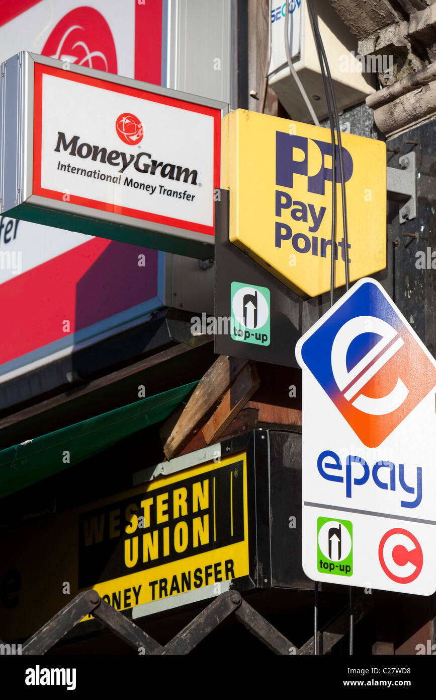 A finance shop advertising Western Union, Money Gram, Pay Point, and
