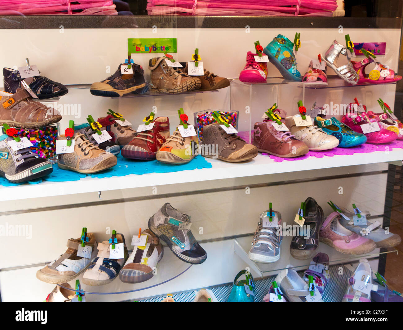 French shoe shop window display of children's shoes, France, Europe - Stock Image