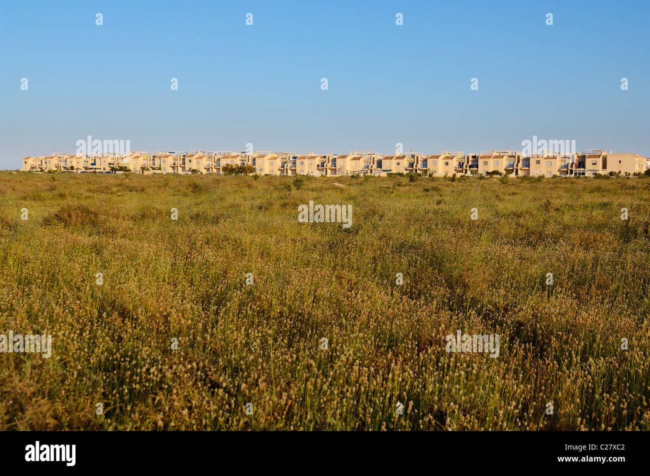 Urban sprawl on the edge of the La Mata Natural Park, Torrevieja, Alicante Province, Spain. - Stock Image