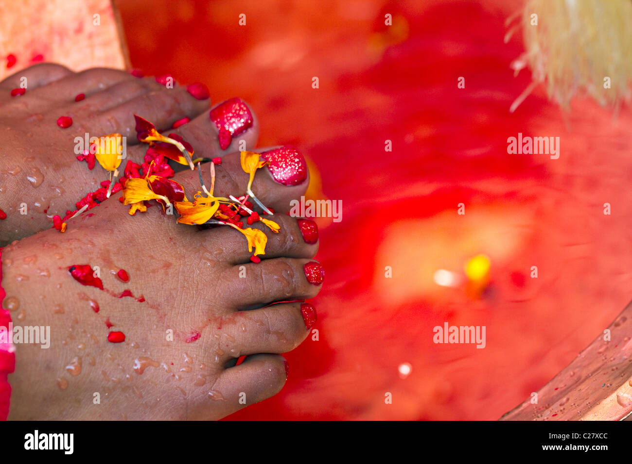 Female feet with flower during a Hindu rite. Nepal, Asia - Stock Image