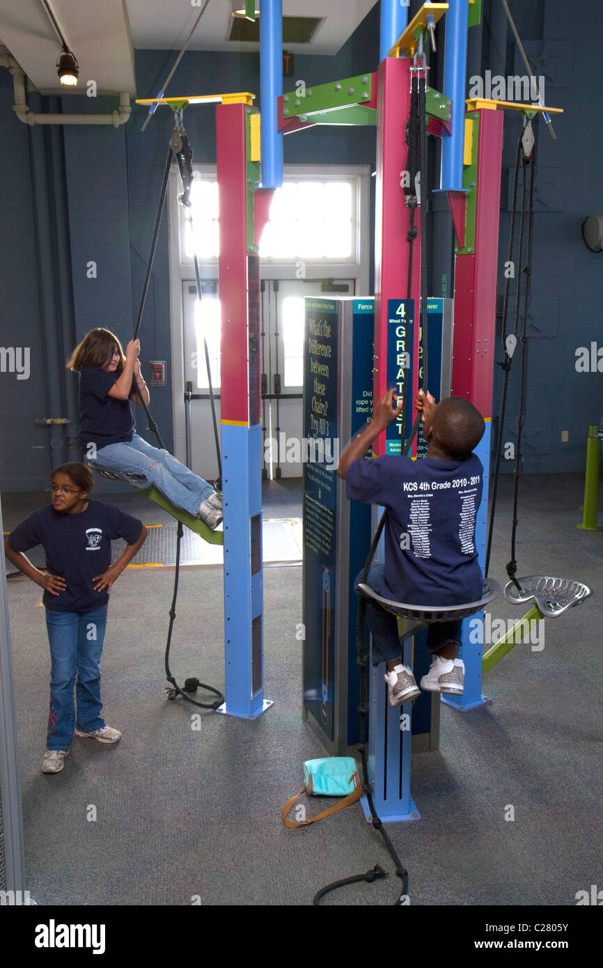 Children using an interactive exhibit at the Gulf Coast Exploreum Science Center in Mobile, Alabama, USA. Stock Photo