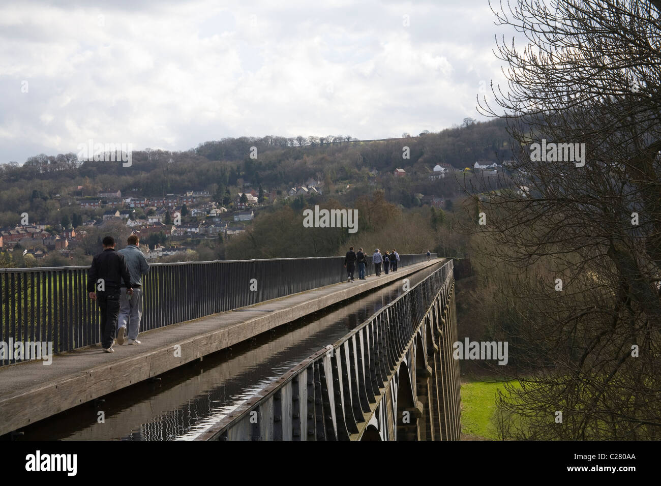 North Wales UK Walkers on towpath along trough of Pontcysyllte Aqueduct built by Thomas Telford carries Shropshire - Stock Image