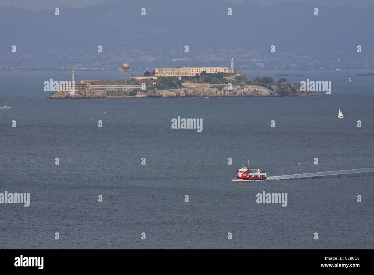 View of Alcatraz Island with ferry passing by, San Francisco Bay, California, USA - Stock Image