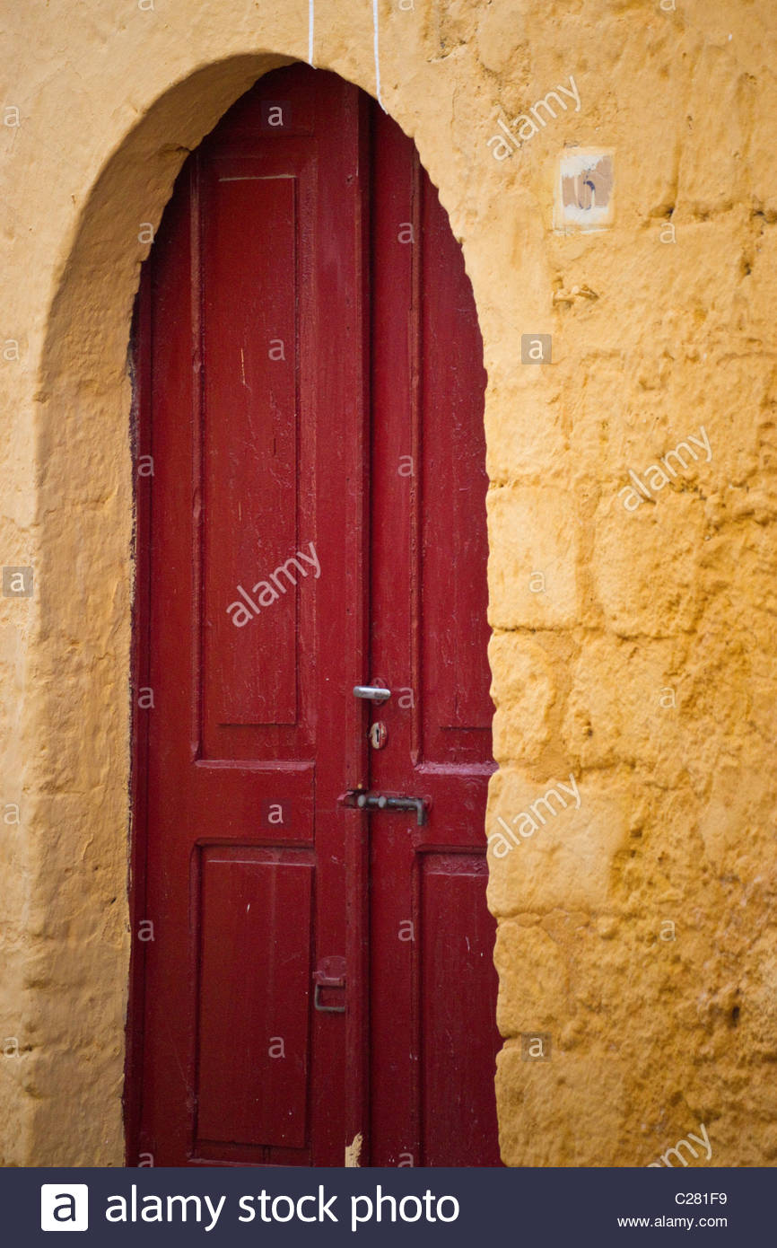 Greek arched wooden entrance door Greece - Stock Image