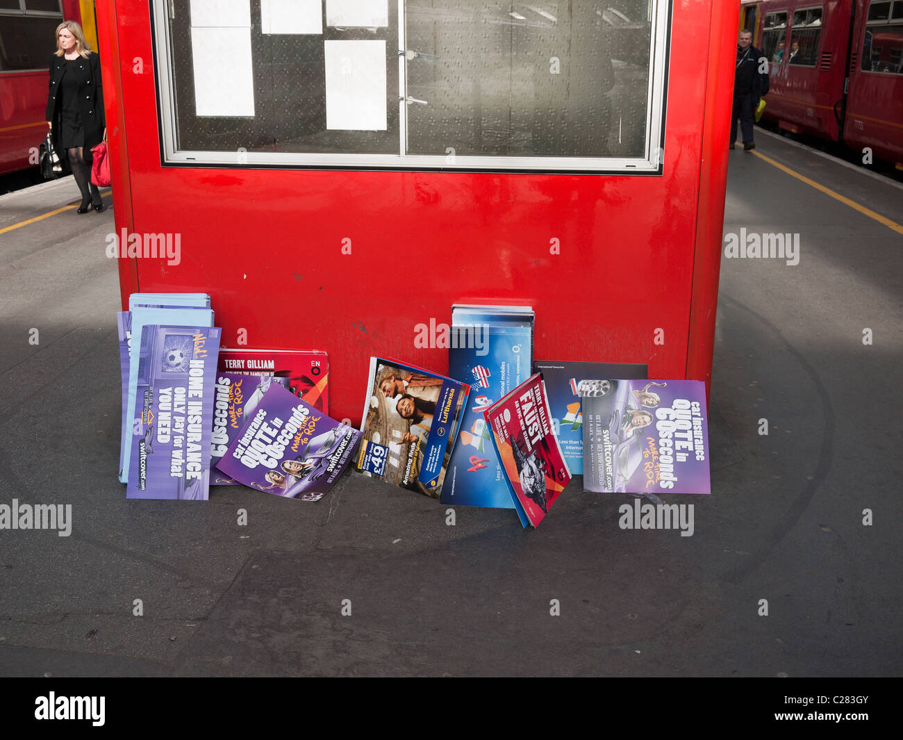 promotional material dumped on station at waterloo London  England - Stock Image