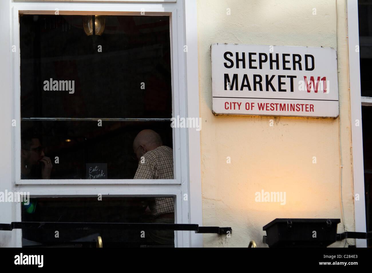 Shepherds Market street sign next to pub window - Stock Image