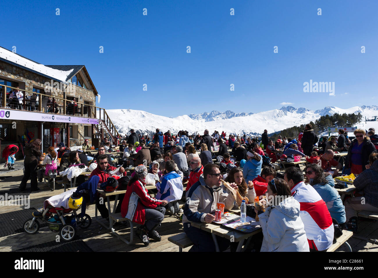 Terrace of a Mountain Restaurant at the bottom of the slopes in the Espiolets ski area, Soldeu, Grandvalira Region, - Stock Image
