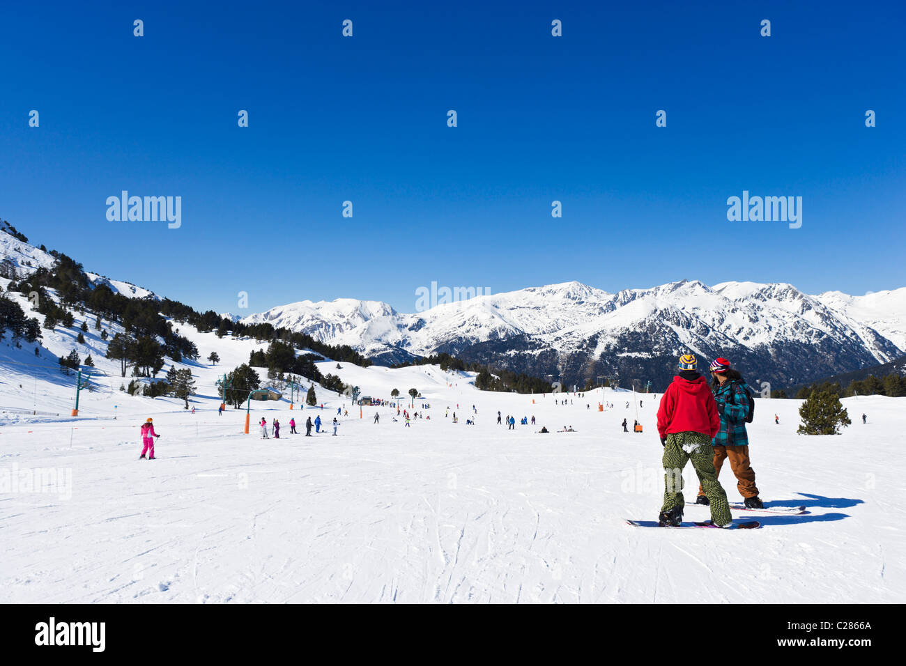 Snowboarders on the nursery slopes in the Espiolets ski area, Soldeu, Grandvalira Region, Andorra Stock Photo
