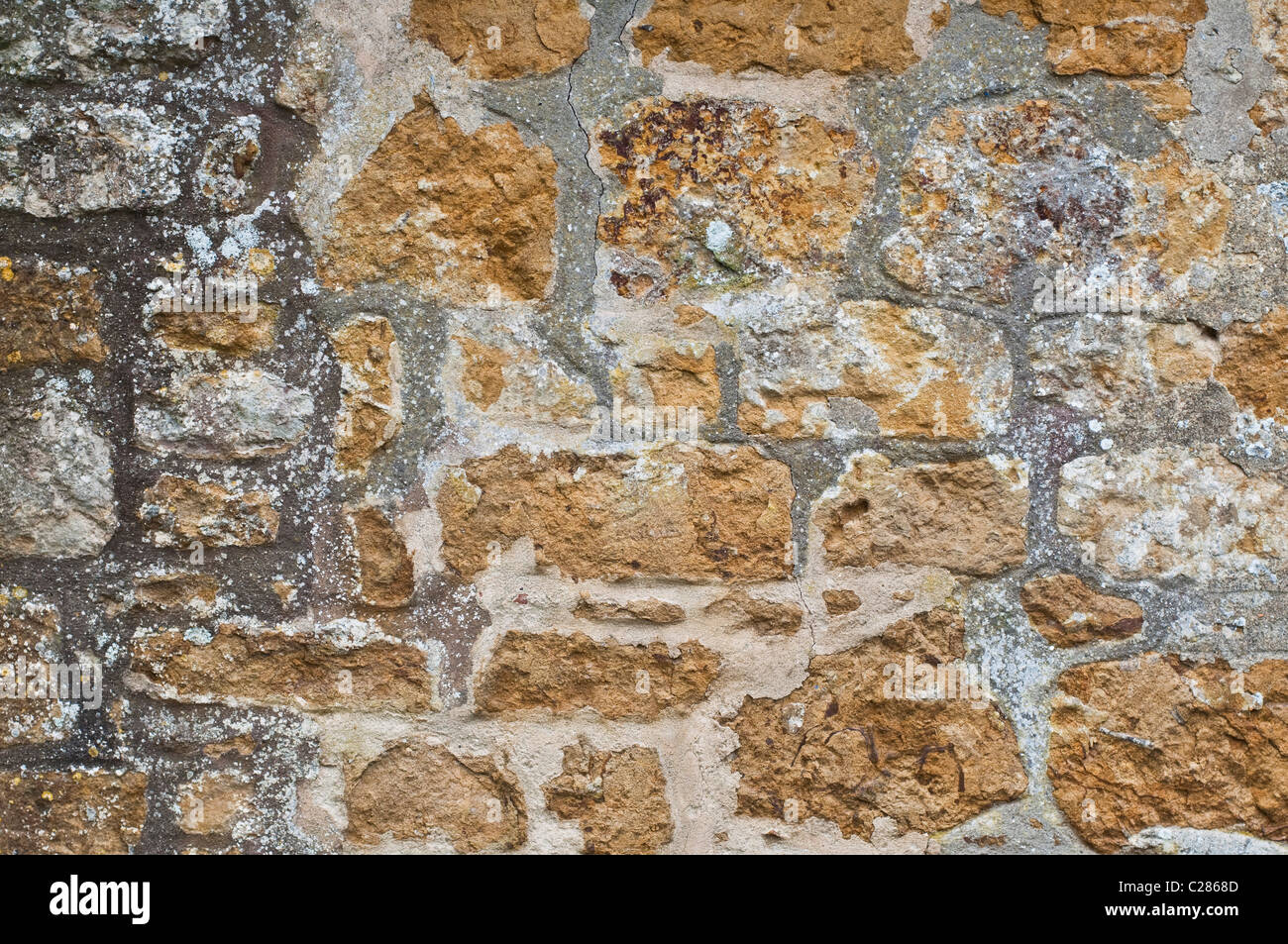 The texture of a stone masonry wall in England, UK. - Stock Image