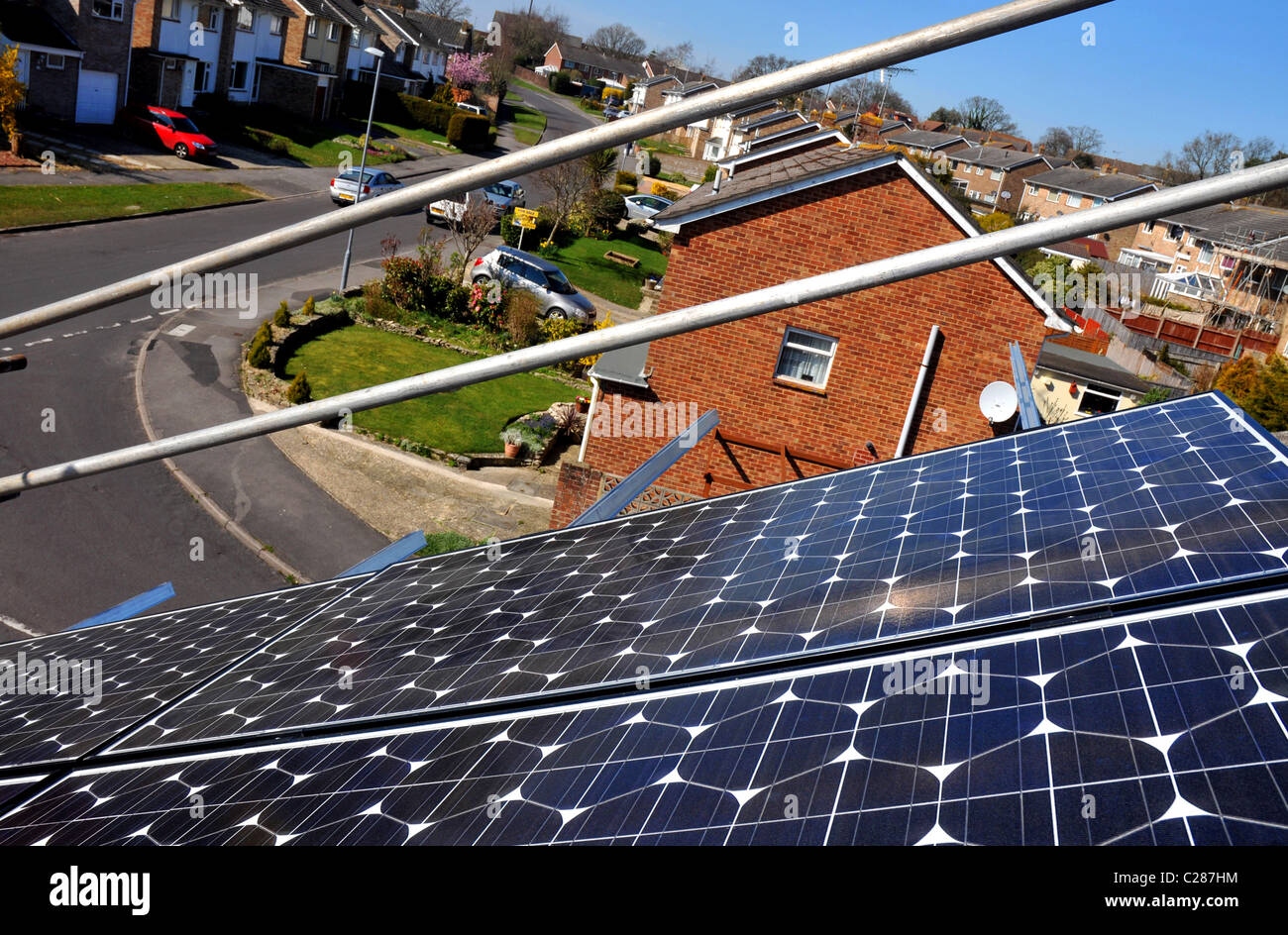 Solar panels installed on a house roof, Britain, UK - Stock Image