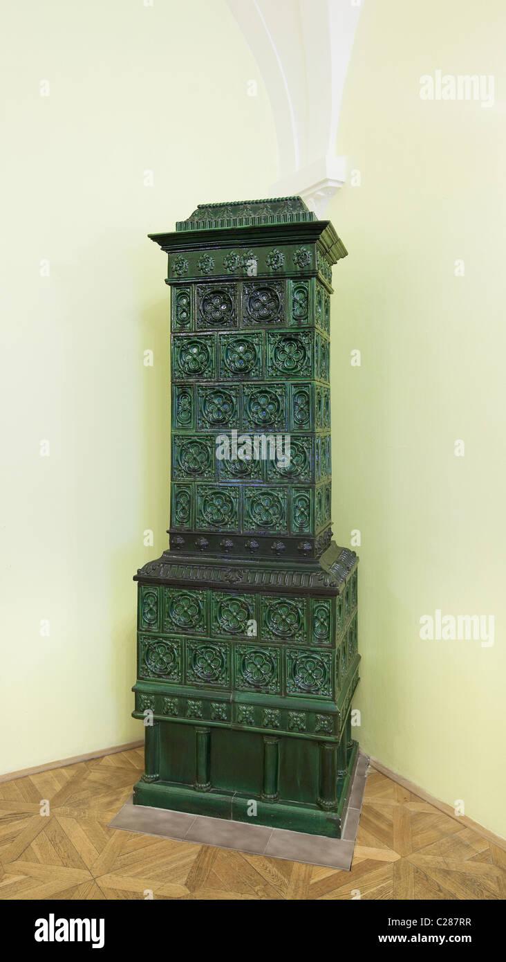 Antique ceramic stove - Stock Image