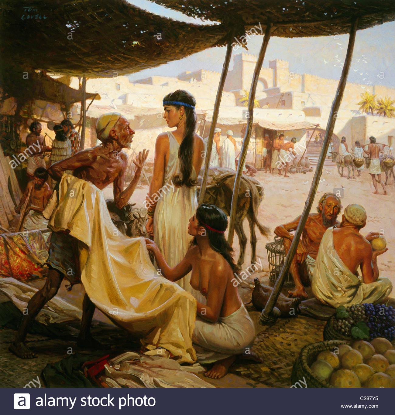 Abraham's wife, Sarai, and a slave bargain for cloth in a marketplace. Stock Photo