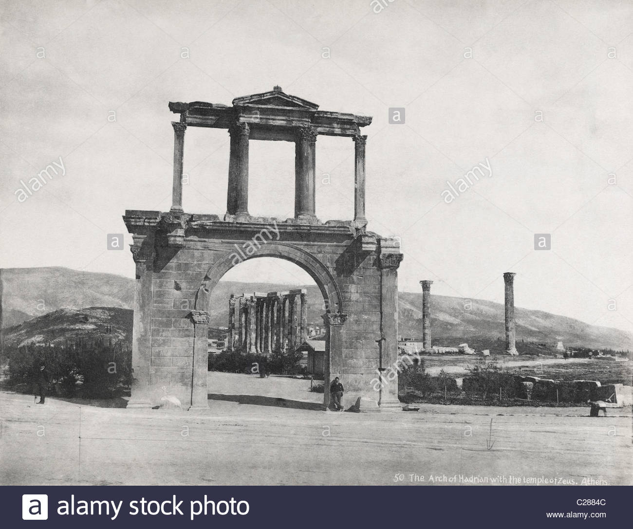 The Arch of Hadrian through which can be seen the ruins of a temple. - Stock Image