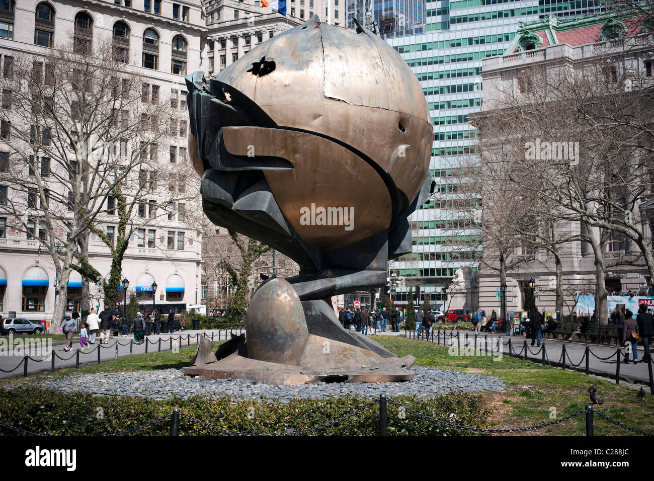 Visitors view 'Sphere' by the sculptor Fritz Koenig on Sunday, April 3, 2011 in Battery Park in New York - Stock Image