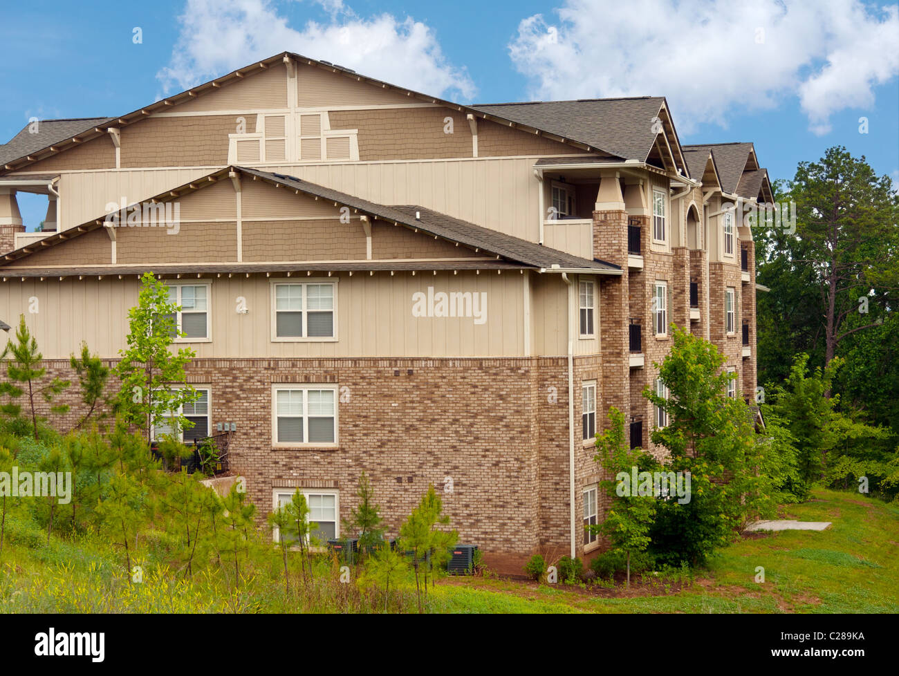 Side view of newly built condominium buildings. - Stock Image