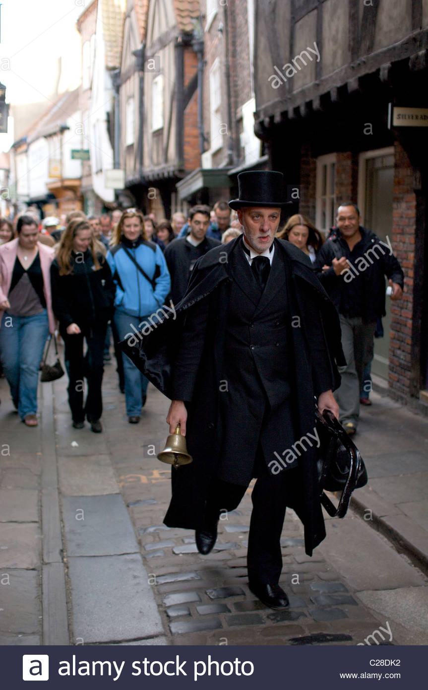 Following a guide on a tour of York's haunted sites. - Stock Image