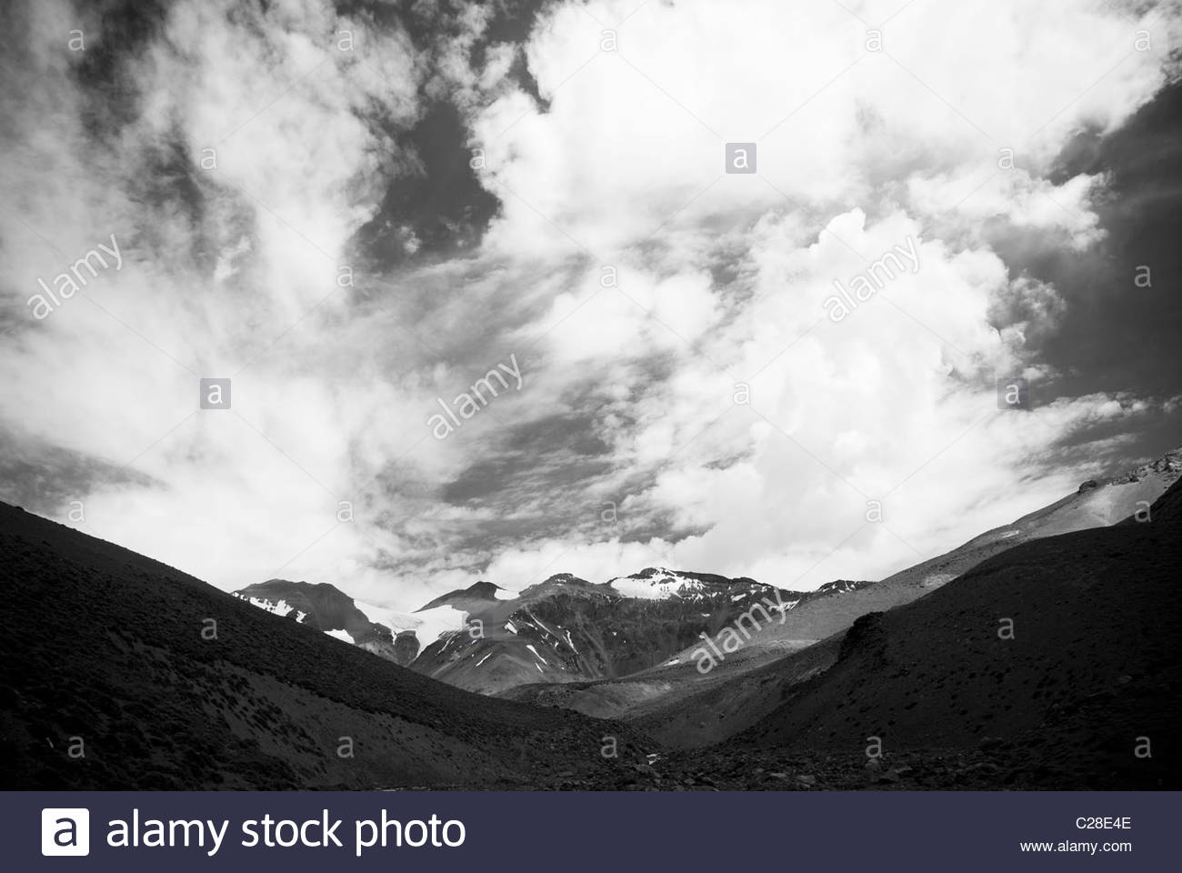 A black and white photograph of the Andes Mountains. - Stock Image