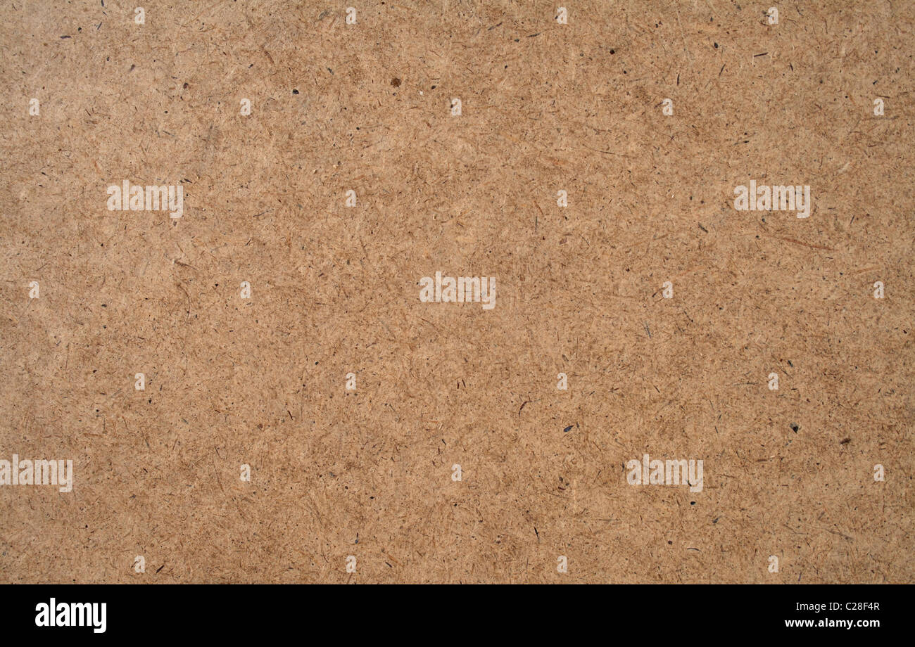 A texture of hardboard or masonite, the material often used for pegboard. - Stock Image